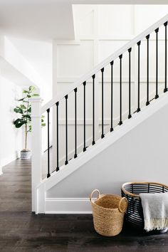 Staircase bright and beautiful for a basement build-out. Black and White Herringbone runner with white on white board paneling. Black metal balusters and white handrails  White Staircase, House Staircase, Staircase Remodel, Staircase Walls, Black And White Stairs, Entryway Stairs, Interior Staircase, Staircase Railings, Staircases
