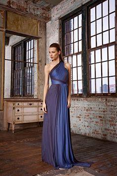 Shop this look on Lookastic:  https://lookastic.com/women/looks/navy-evening-dress/10911  — Navy Evening Dress