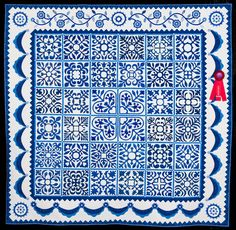 2015 Quilt Expo Quilt Contest, 2nd Place, Category 4, Machine Quilted Bed Size Appliquéd: Sarah's Revival in Blue, Gail H. Smith, N. Barrington, Ill. quiltexpo.com