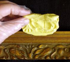 Use BONDO to repair missing portions of ornate picture frame. Using BONDO, tutorial on how to create a mold first and then fill the mold to duplicate a missing piece of a doorframe. Use this same set up to make a mold of ornate picture frames that have portions of the molding missing. When it hardens sand and paint the whole frame.  You just saved a piece of trash and gained an expensive picture frame!