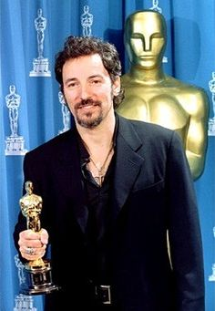 """1994-03-21 - DOROTHY CHANDLER PAVILION, LOS ANGELES the winner is... Bruce Springsteen! 66th Academy Awards. Bruce wins an Academy award for """"Streets Of Philadelphia"""" in the """"Best Original Song"""" category."""