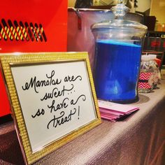 Sign for Manolo event at Saks in Raleigh.  Oscar William Gourmet Cotton Candy and Jennifer V Event Design & Planning.
