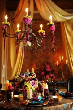 Blooms by Martha Andrews . Tablescape and decorated chandelier! Love