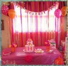 use this idea on closet doors - streamers, garland across front, balloons on side, flowers on table