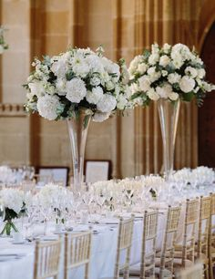 Romantic luxury tall white flower table centres for an Oxford college wedding