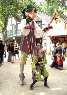 Bristol Renaissance Faire, love that the puppet is the puppeteer!during the recent strike by chorus members at the roll up circus we had to take drastic action to get the girls to go back to work perfect performance was resumed don't you think Bristol Renaissance Faire, Stilt Costume, Living Puppets, Daughter Of Smoke And Bone, Marionette Puppet, Dragon Puppet, Puppet Making, Shadow Puppets, Madame Alexander