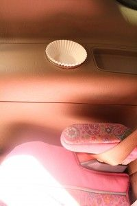 Paper cupcake liners in the car. Use them to keep cup holders clean
