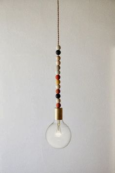 The Johnston's: {DIY wooden bead light fixture}