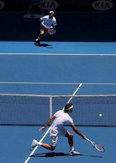 Lleyton Hewitt and Roger Federer practice at Melbourne Park Jan 8 2013 Getty Images