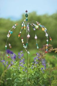 jeweled garden stakes, this would look fantastic in my flower bed.