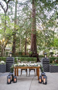 All natural tables and chairs elevate the look of a forest wedding.