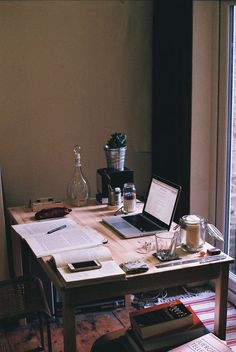 An ideal writing space with plenty of natural light (and a candle for those Eskom power cuts) -more inspirational writing desk ideas after the jump ^_^