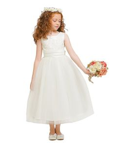 KID Collection Girls Ivory Flower Girl Wedding Dress K1217 Size 12. Elegant Floral Decorated Poly Satin Bodice Dress with Tulle Skirt. Fully Lined with Rear Center Zipper and Adjustable Tie in Back Sash. Extra Netting Inside Skirt for an Added Volume Look. Great for Flower Girl, Holiday and Any Special Occasion. Made in U.S.A.