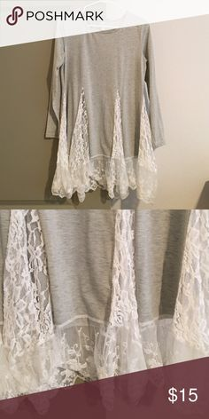 Light Gray long sleeve with lace bottom Light gray, super cute lace detail on bottom! Since lace is sheer, can't really be worn as dress but long enough for leggings or skinny jeans! Super comfortable, always get tons of compliments on this one! Tops Tees - Long Sleeve