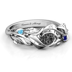 A 10k white gold black diamond engagement ring with my both my boyfriend's and my birthstones.