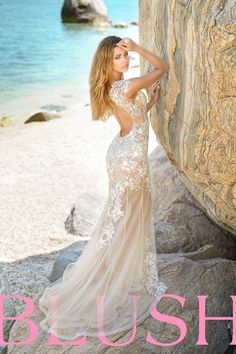 Miss USA has arrived! Gorgeous nude illusion gown adorned with floral leather appliqués and clear crystal accents. This style is sure to turn heads as you glide across the stage showing off the open back and sheer train. Side zipper closure. Available in Champagne/Ivory. #BlushProm #Prom2015 #promdress
