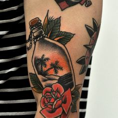 Mason jars contain multitudes, and these jar tattoos show just how far we can go with scenes inside of jars.