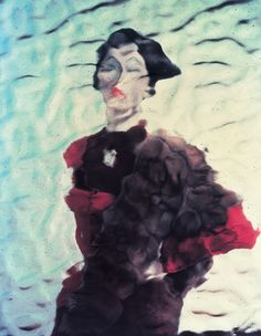 Erwin Blumenfeld, Untitled (1953), New York Blumenfeld always tried to introduce and revise techniques he had developed through his experience. In this portrait of model Dovima, he relies on his masterly control of lighting. The photograph was taken through a rippled glass pane. The bubbles in the glass appear as small dots on the photograph.