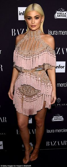 Pretty in pink: The 19-year-old Keeping Up With The Kardashians star donned an interesting pale pink fringed mini dress with beaded embroidery and cut-out shoulders