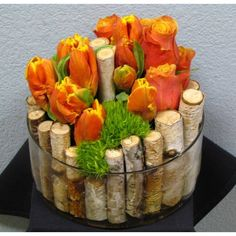 Unique arrangement with Cherry-Brandy Roses and Orange Tulips with Yellow Tip, Green Trick and Birch Stumps in a low glass cylindar vase. Design Floral Moderne, Modern Floral Design, Ikebana, Deco Floral, Arte Floral, Flower Centerpieces, Flower Decorations, Fresh Flowers, Beautiful Flowers