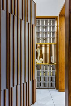 The residence portrays a very interesting strategy of using wood and It enhances the perceptual quality of the residence interior space. Wooden Door Design, Main Door Design, Foyer Design, Gate Design, Ceiling Design, Door Design Interior, Home Room Design, House Design, Room Partition Designs