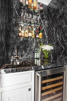 Graphic, lightning bolt veins collide with a cloudy black backdrop in this clever bar niche. Aria Stone Gallery's Grigio Carnico Marble is the epitome of modern and makes a bold statement no matter the application.