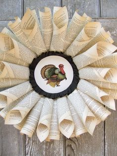 Thanksgiving wreath.  Would also be cute for Christmas using Christmas song sheet music and ditch the turkey for a tree.