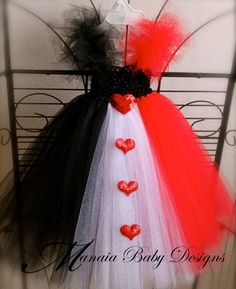 Queen of hearts: Make this tutu, wear a black tank, red lipstick with heart on cheek and false lashes. Don't forget the crown with a heart!