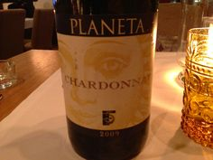 In Moscow  La Bottega Siciliana Restaurant Planeta Chardonnay 2009 Sicily.Yellow gold color with medium forming legs and aromas of lemon and orange blossom. It's balanced and has flavours of lemon with a medium body. Juicy texture with a long finish. Score 90 points