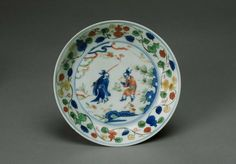 Pair of saucers with immortals in mountains, Ming dynasty (1368-1644), Jiajing six-character marks within double-circles and of the period (1522-1566), China, Jingdezhen, Jiangxi province. Porcelain with underglaze and overglaze polychrome decoration, wucai. H. 1 1/4 in x Diam. 6 3/4 in, H. 3.2 cm x Diam. 17.1 cm. The Avery Brundage Collection, B60P2069 & B60P2070. © 2016 Asian Art Museum Chong-Moon Lee Center for Asian Art and Culture
