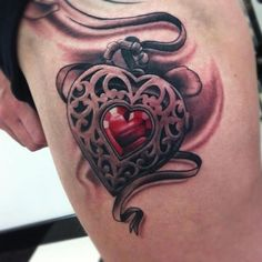 Ruby-jeweled black and gray heart locket by Pete The Thief
