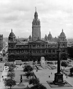 Glasgow City Chambers, looking east across George Square in 1955. The statue of the author Sir Walter Scott is perched on the tall column in the foreground. The Cenotaph, built in 1922 to commemorate the Glaswegians who died in the First World War, is located in opposite the entrance to the City Chambers (centre).