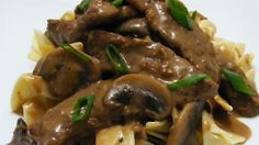Strips of chuck roast simmered with green onions and mushrooms, then flavored with mustard and a good Rhine wine make a delicious beef stroganoff.