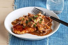 Sesame dressing and a splash of soy sauce gives this quick Pan-Roasted Chicken with Shiitake Mushrooms an Asian-style appeal.