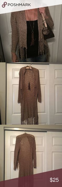 RUE 21 long fringed sweater. RUE 21 Long fringed tan sweater.  Very gently used condition.  Size medium but seems more like a small. Very versatile.  So fun to wear with jeans or leggings and boots.  Great for early fall. Rue21 Sweaters Shrugs & Ponchos