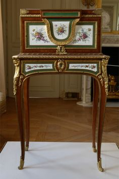 Marie Antoinette's coffer.  Notice the   roses painted on the porcelain  panels. ~Titillating Tidbits
