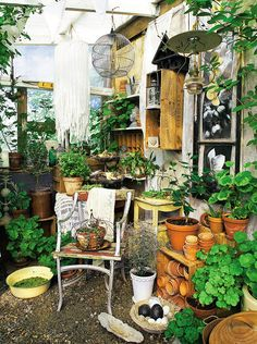Terracotta pots, rustic birdhouses and vintage lanterns transform a potting shed corner into a country gardener's retreat; the perfect place to browse through seed catalogues