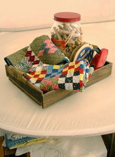 sweet mini quilt vignette, it needs to be sitting on a cute little wood ironing board.