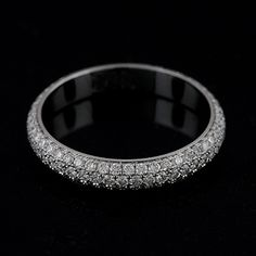pave diamond wedding band. 2 of them, one for either side of the engagement ring