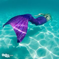 Realistic, swimmable Mermaid Tails in Asian Magenta. Make a beautiful splash!