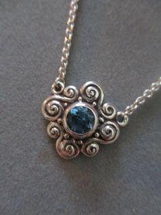 Sterling Silver Swiss Blue Topaz Swirl Pendant #PDT24SST by RichelleJewelry on Etsy