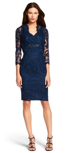 A stunning lace dress features a flattering neckline, finished with delicately scalloped edges and removeable bolero