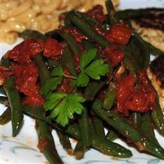 Green Beans in Tomato Sauce Allrecipes.com - onion, garlic, parsley, canned diced toms, white wine vin, cumin, pinch sug, S&P, olive oil, garlic