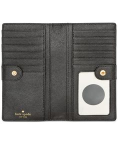 An easy, symmetrical design keeps cards, cash & Id efficiently organized in this kate spade new york Cedar Street wallet, crafted in chic colorblock leather. | Leather; lining: polyester | Imported |