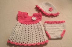 Crochet baby dress, hat and diaper cover in pink and white with flower and button accessory