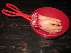 Make Gory Hand Salad Tongs for Halloween Party.....so easy....dollar store here I come!