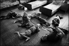 BELARUS. 1997. Novinki Asylum, Minsk. These boys are unable to walk. They move by crawling, rolling, or sliding.  Paul Fusco/Magnum Photos