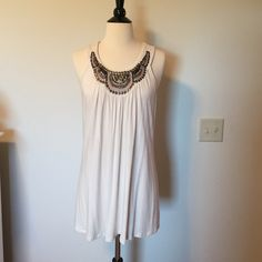Beaded front tunic Off white color tunic with pretty beading! Great condition, only worn a couple times! I cut the size tag out but this could fit small or medium. Tops Tunics