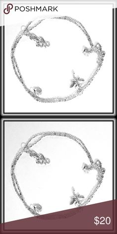 "ANKLET / BRACELET DRAGONFLY, FISH, & SQUID Frivolously fun, this shiny anklet will go with you to the beach, to work or to the grocery store and remind you of of the importance of light heartedness!                                                                                                                                                         Labeled 0.925      11"" Length Jewelry"