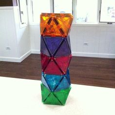 Magna-Tiles Challenge! Build a tower using this pattern! The base is made with 1 square and the walls are made with 8 equilateral triangles. There is a small square between each layer to provide support and make it stand tall! Magna-Tects will need patience, balance, and steady hands to build this cool tower. Don't give up! Magna-Tect Tip: gently cup your hands around the sides to lift the pieces so that they are aligned nicely and receive more support!